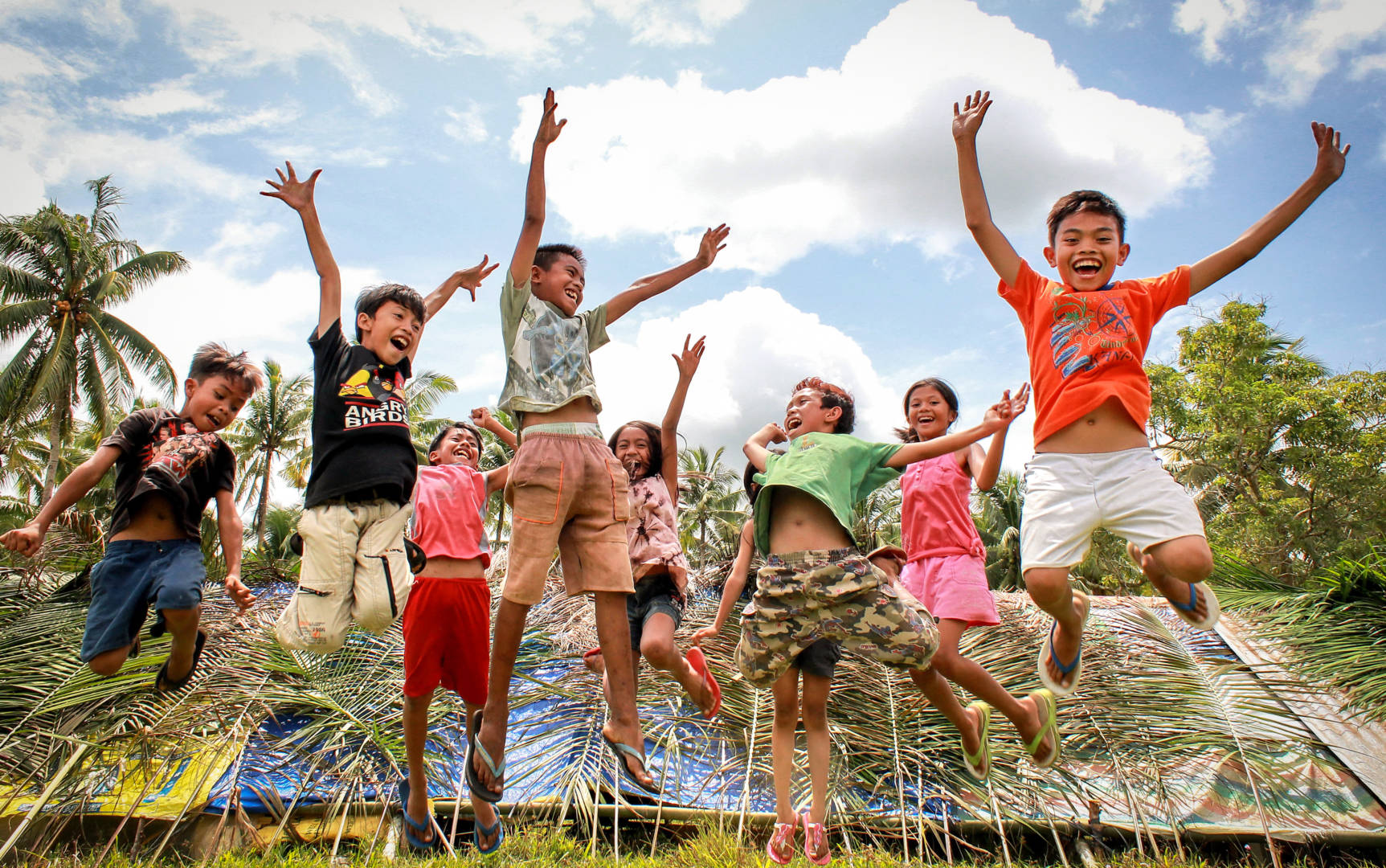 Joyful children in World Vision project jump and play ©World Vision