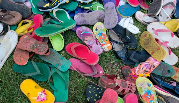 Children piled their shoes at the entrance
