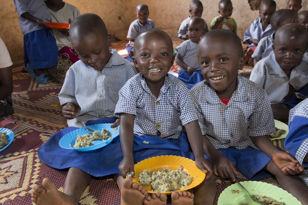 Children enjoy a nutritious meal at a World Vision program in Rwanda. PHOTO: World Vision / Ilana Rose