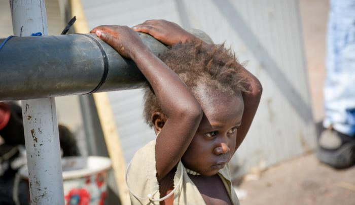 A young girl at Malakal's United Nations Protection of Civilians area. The displaced people are facing many challenges after recent conflicts forced them from their homes. PHOTO: Michael Arunga/World Vision