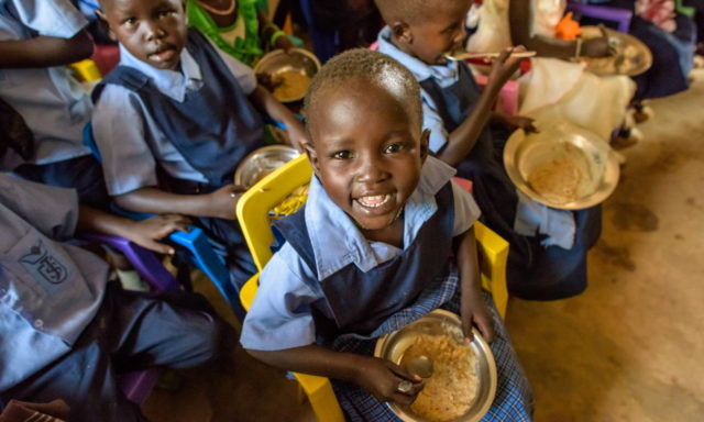 Children enjoy a nutritious meal at St. Joseph School in Kuajok, one of many World Vision