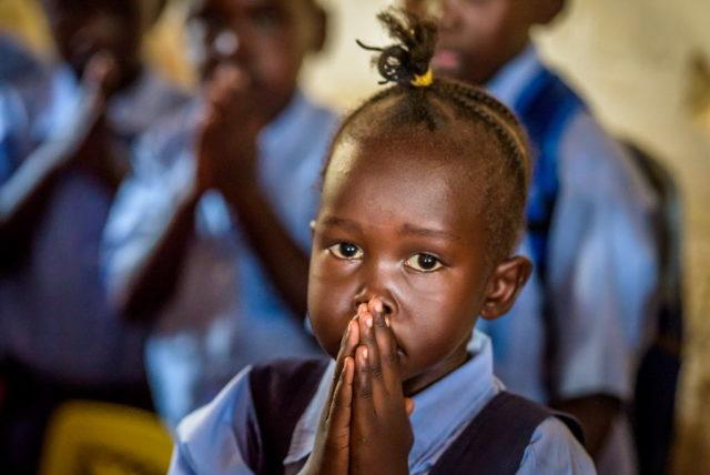 ©2015 Jon Warren   World Vision. Girl praying.