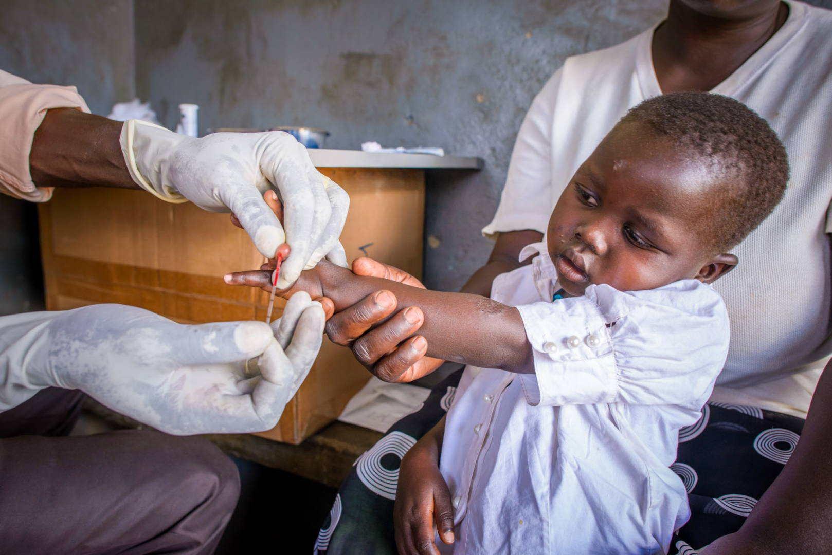 This World AIDS Day, Dec. 1, families and health workers celebrate that child HIV rates dropped 60 percent between 2009 and 2015 in 21 sub-Saharan African countries including Uganda.