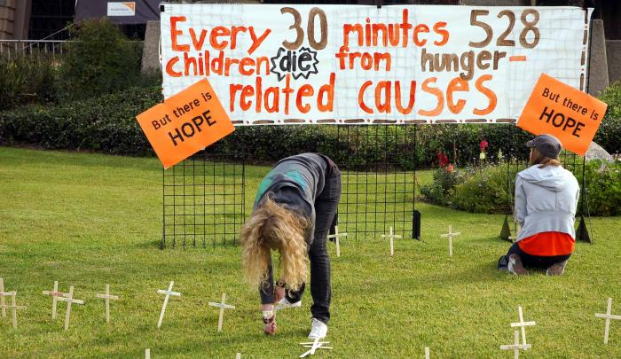 As part of their 30 Hour Famine experience, students mark symbolic graves for children who die of hunger each day.