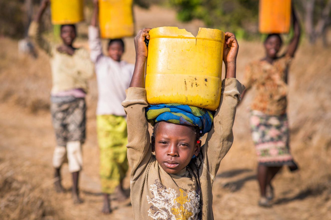 Dorcas, 9, carried dirty water home four times a day from a pond where animals drank, and sometimes died. Everything changed when World Vision dug a well. Now she has clean water.
