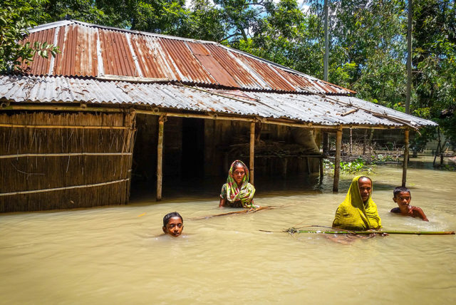 Women and children return to their flood-damaged home in Kamalapur, in northern Bangladesh. (©2016 World Vision, Richard Barman)