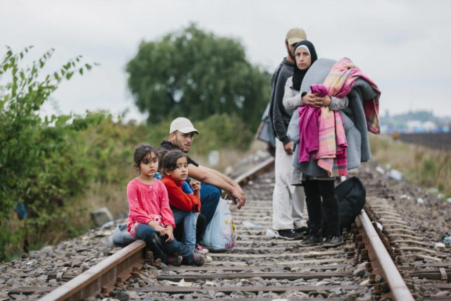 Forced to flee: Refugee family on train tracks