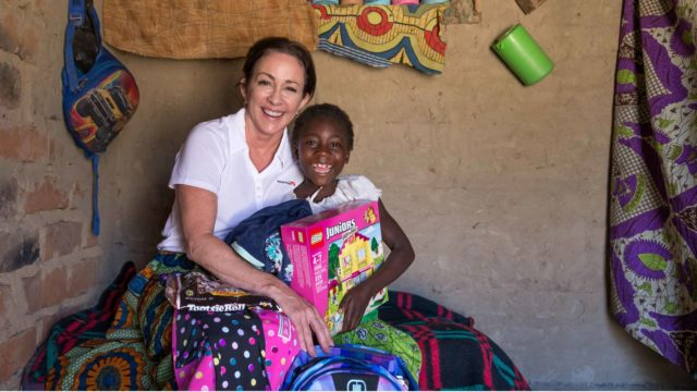 Actress Patricia Heaton meets her World Vision sponsored child 8-year-old Gracious, in Hamaundu, Zambia.