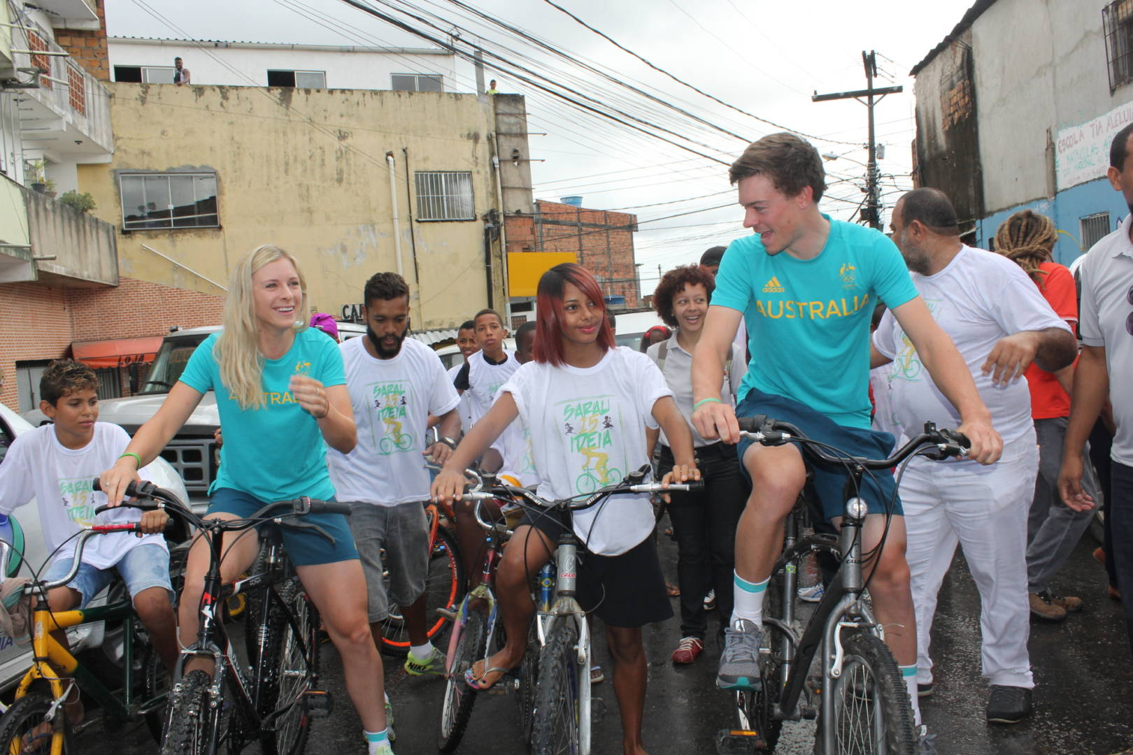 Olympian cyclists Annette and Alex Edmondson ride bikes with World Vision sponsored child Vanessa and her youth group in Brazil.
