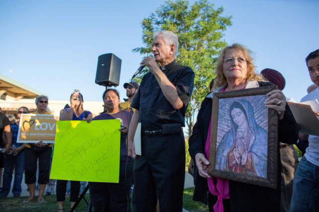Father Jack Barker of St. Martha's Catholic Church in Murrieta, Calif., spoke at a vigil. Credit Monica Almeida/The New York Times