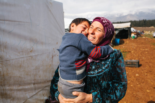 Oumayma and her son Ali fled with their family after their home town in Iraq was hit by bombs. (©2015 World Vision, Jo Currie)