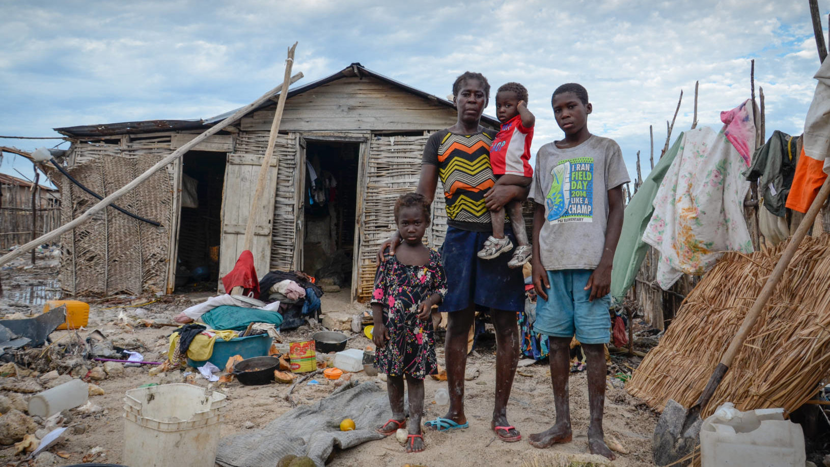 Hurricane Matthew photos: After Hurricane Matthew in Haiti, mom, stands with children in front of damaged house