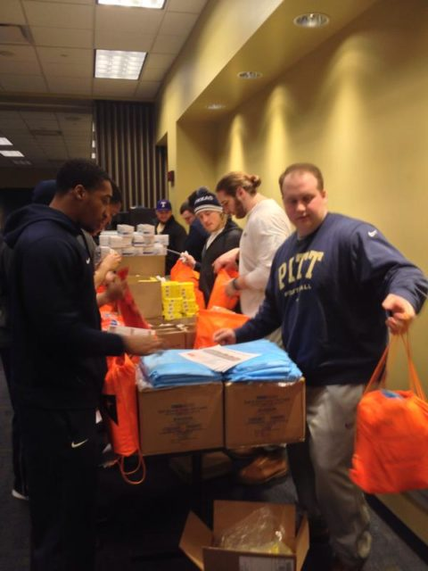 The University of Pittsburgh football team and World Vision partnered to build Ebola Caregiver Kits for health workers in Sierra Leone. PHOTO: Courtesy, University of Pittsburgh