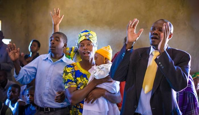 20 years after Rwanda genocide, families that were once enemies now worship together. PHOTO: Jon Warren/World Vision