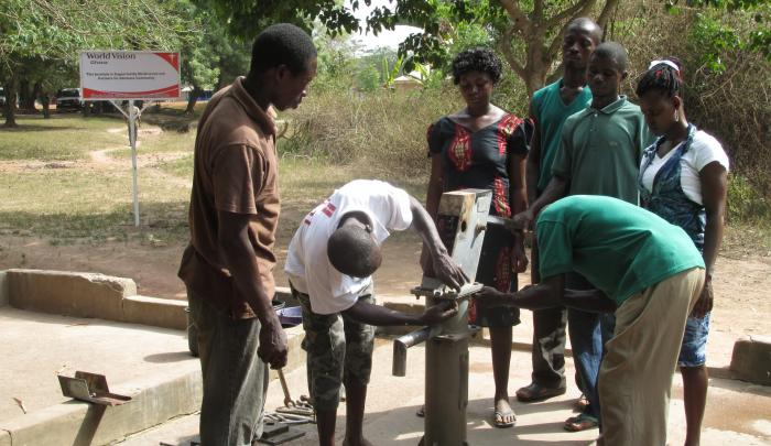 A local repair committee in the Greater Afram Plains region of Ghana fix a well provided by World Vision.