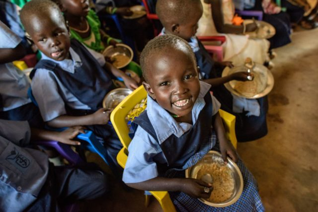 Children have lunch at a World Vision supported school in South Sudan. PHOTO: Jon Warren / World Vision