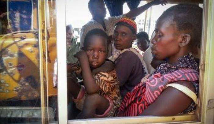 Families displaced by the violence in South Sudan wait on a crowded bus in Juba, hoping to flee to safety.
