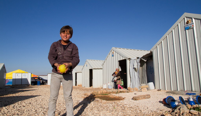 "Mohammed is in sixth grade and enjoys football (soccer). His favorite position is goalkeeper. ""The thing I miss the most about Syria, he says, is my home. I miss my relatives, neighbors and friends."" PHOTO: ©2015 Suzy Sainovski / World Vision"