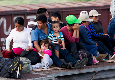 Central American migrants ride a freight train during their journey toward the U.S.-Mexico border in Ixtepec, Mexico on July 12, 2014. Eduardo Verdugo—AP