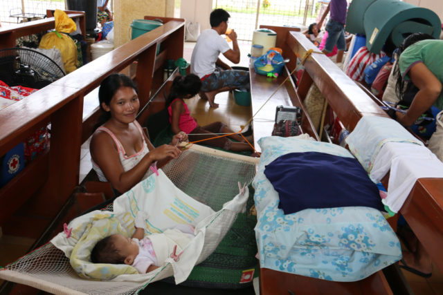Families take shelter inside evacuation centers throughout Tacloban, in advance of the approach of Typhoon Hagupit to the Philippines. PHOTO: World Vision / Cristie Macabe