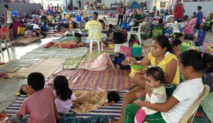 Families at an evacuation center as Typhoon Haiyan makes landfall