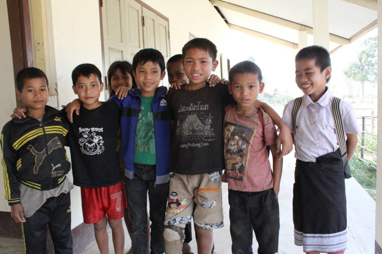 Group of boys in Laos - boy with prosthetic leg. Removing bombs (©2014 World Vision, Nila Douanesouvanh)