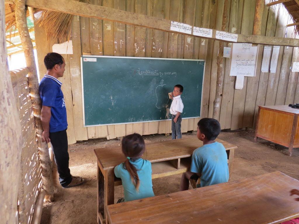 little boy at blackboard