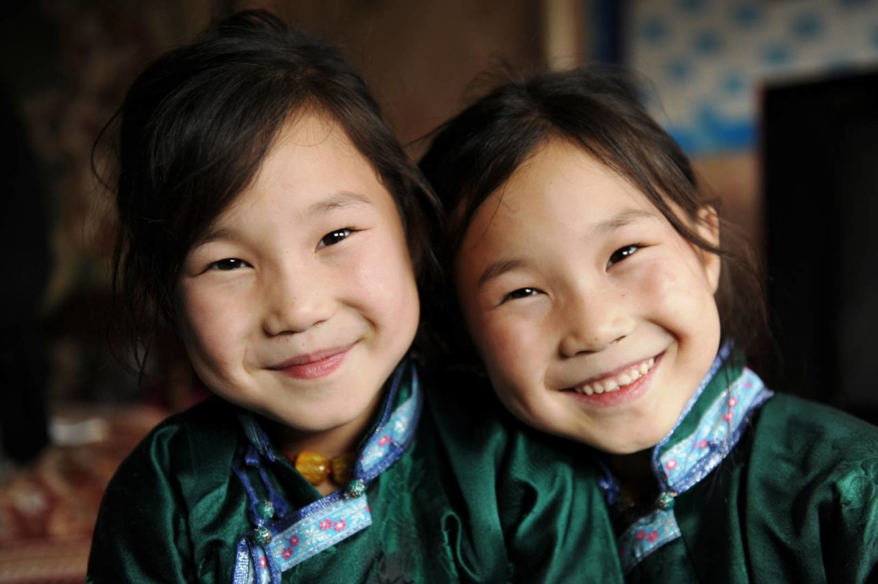 Twin girls in matching green outfits, matching gifts, employee gift matching ©World Vision