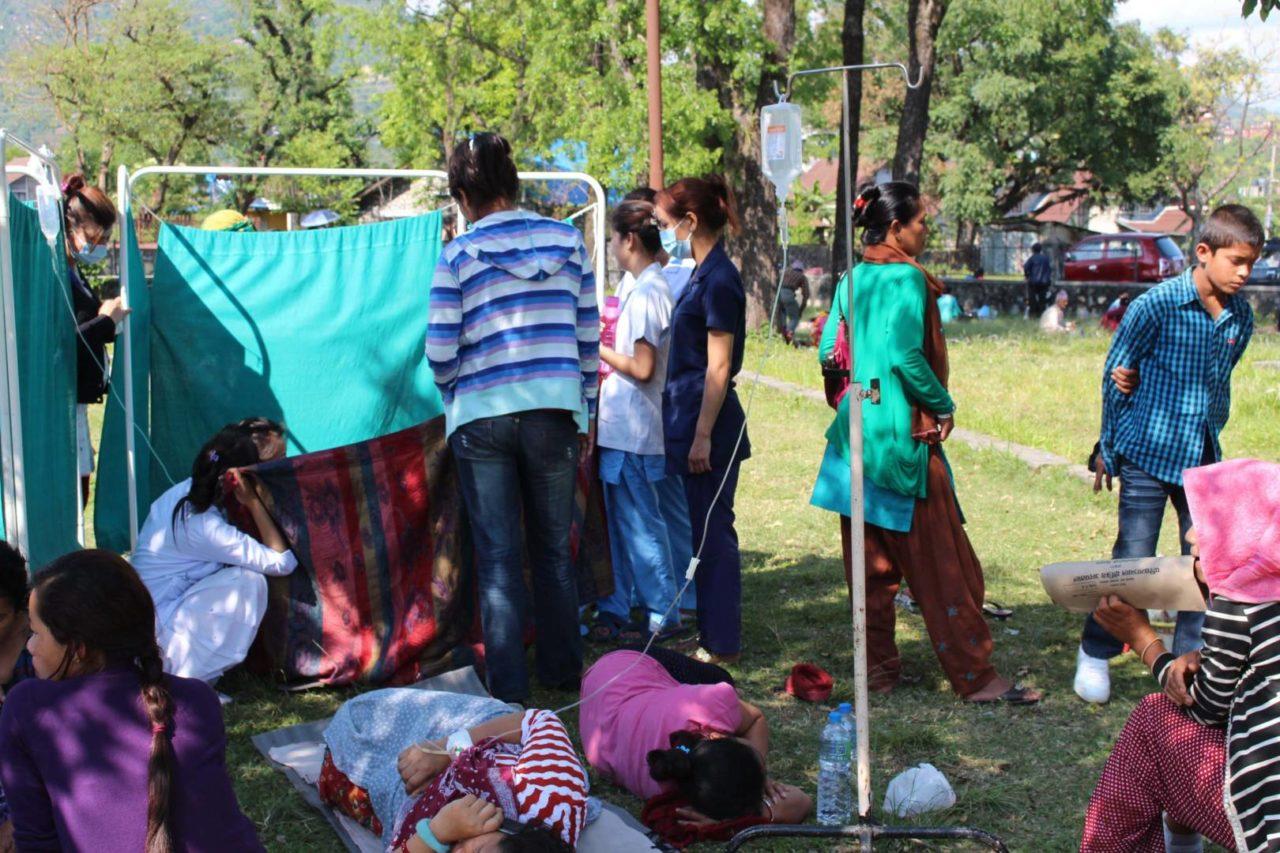 The injured wait outside of Western Regional Hospital in Pokhara