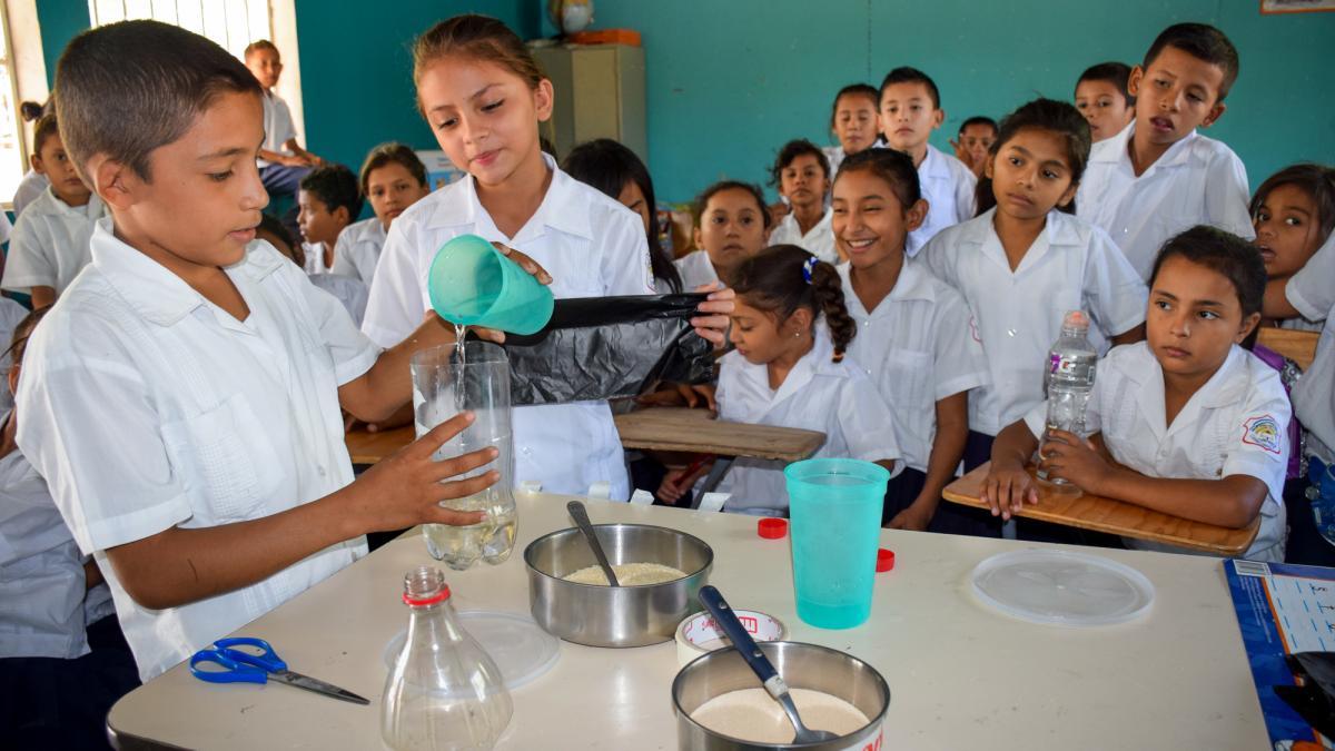 School children in Honduran classroom in front of their class