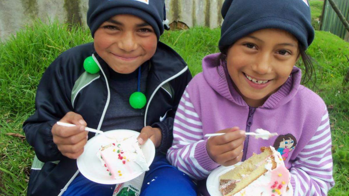Ecuador, sponsored children eating birthday cake