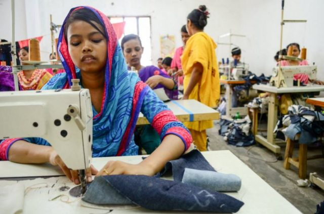 A child works in a garment factory in Bangladesh. PHOTO: World Vision