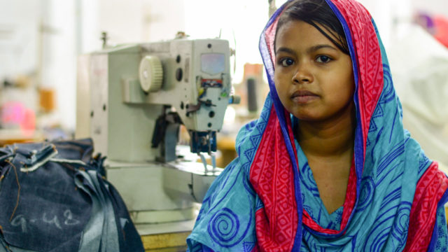 Bithi sits in front of a sewing machine (©2015 Mark Nonkes/World Vision)
