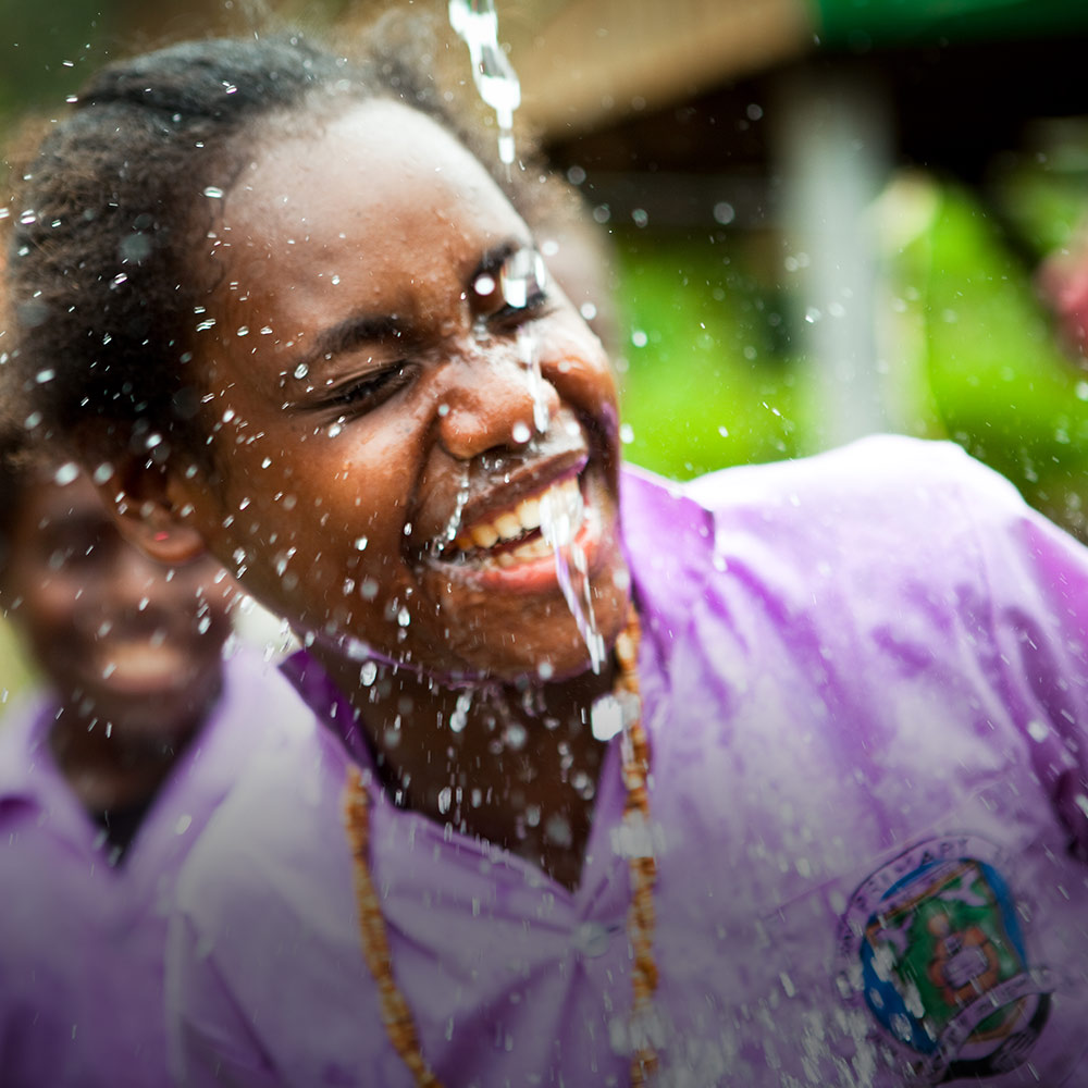 Betivatu Community High School students enjoy the water tap, one of the benefits of World Vision's Honiara School Water Sanitation and Hygiene project