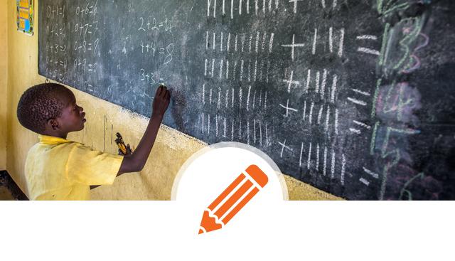 african child at blackboard - education, school ©World Vision