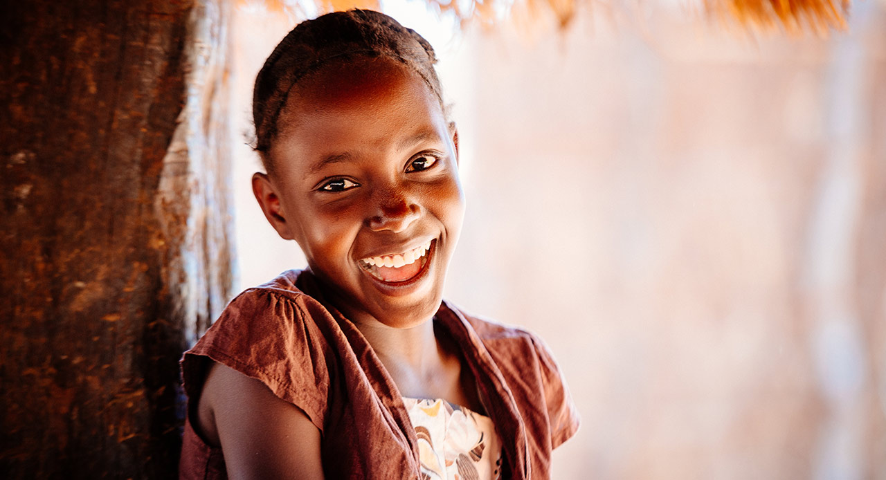 Everlyn's future is bright, as child sponsorship and clean water have made all the difference. She's in school, her mother's garden is thriving, and her father's faith is stronger.