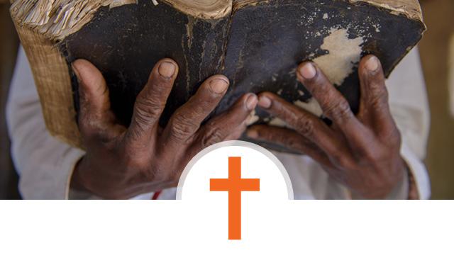 Our Faith - World Vision's Christian faith - cross and Bible ©World Vision