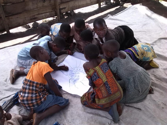 "Girls in Bulengo Camp (Goma, DRC) drawing a ""spider diagram."" PHOTO: World Vision"