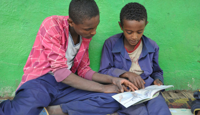 Giduma taught his siblings to read. How? Reading Buddies, a World Vision program that trains children how to read with and teach other kids how to read.