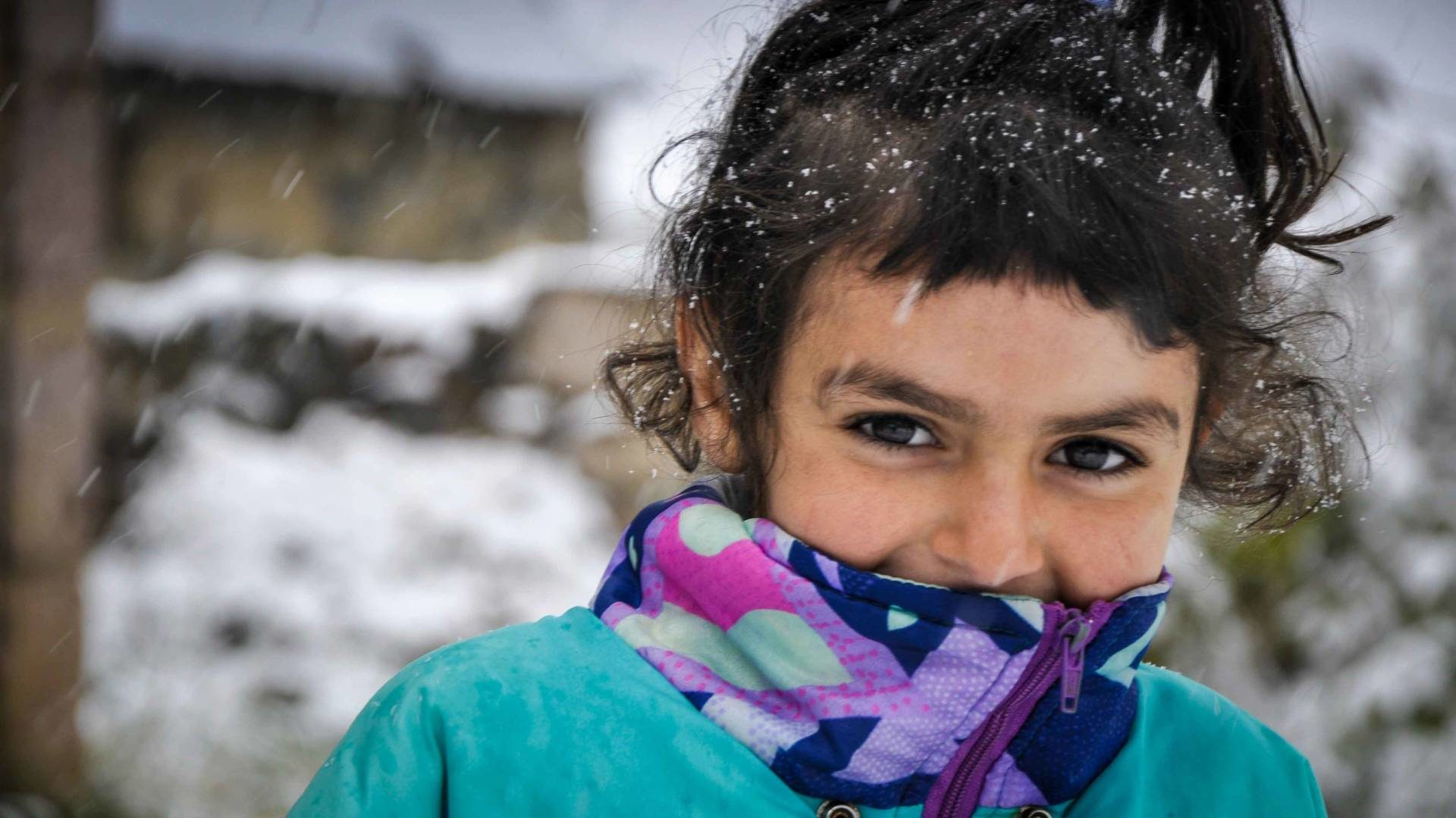 Nelly, 8, escaped fighting to Northern Armenia, and is grateful for the clothes, shoes, and toys World Vision provided.