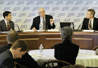 Victor Boutros (L), World Vision President Richard Stearns, and Tom Walsh (R) discuss the importance of fighting for the less fortunate at the 2014 American Enterprise Institute's Evangelical Leadership Summit in Washington, September 10, 2014.