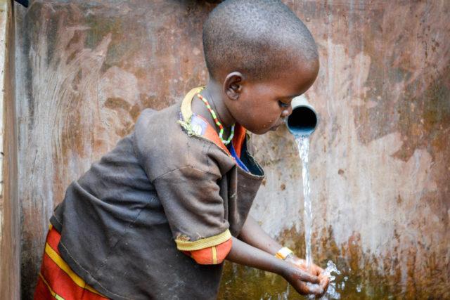 A boy in Burundi receives clean water. PHOTO: World Vision