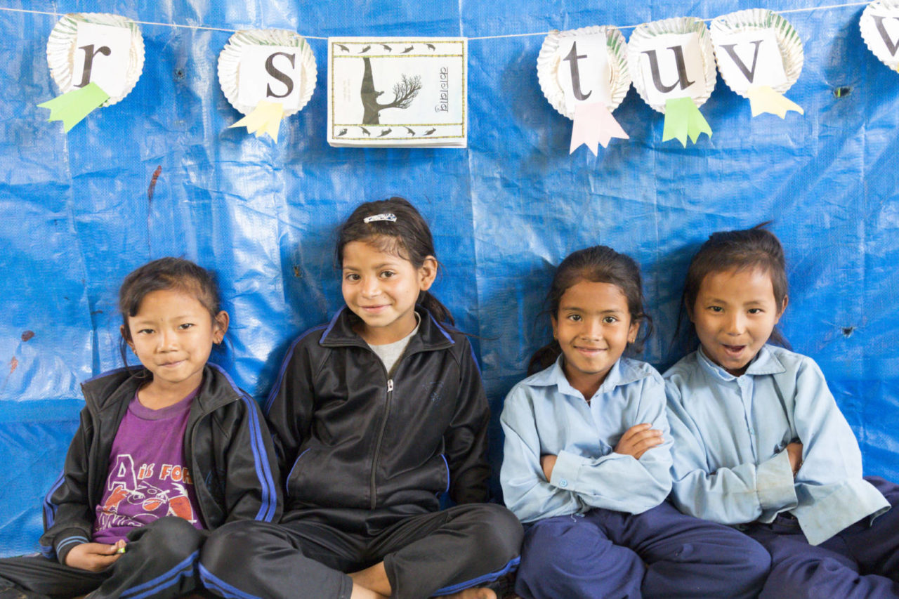 Children in Nepal enjoy playing and learning with their friends in a temporary learning center built by World Vision. CREDIT: World Vision/Laura Di Ciero