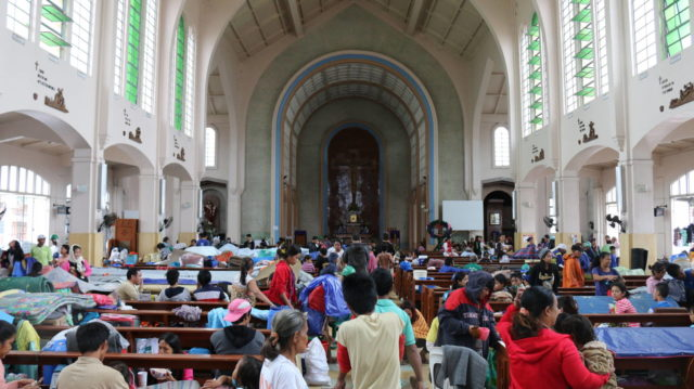 Families seek shelter in Redemptorist Church in Tacloban after Typhoon Hagupit brought punishing wind and rain to the Philippines. PHOTO: World Vision / Joy Maluyo