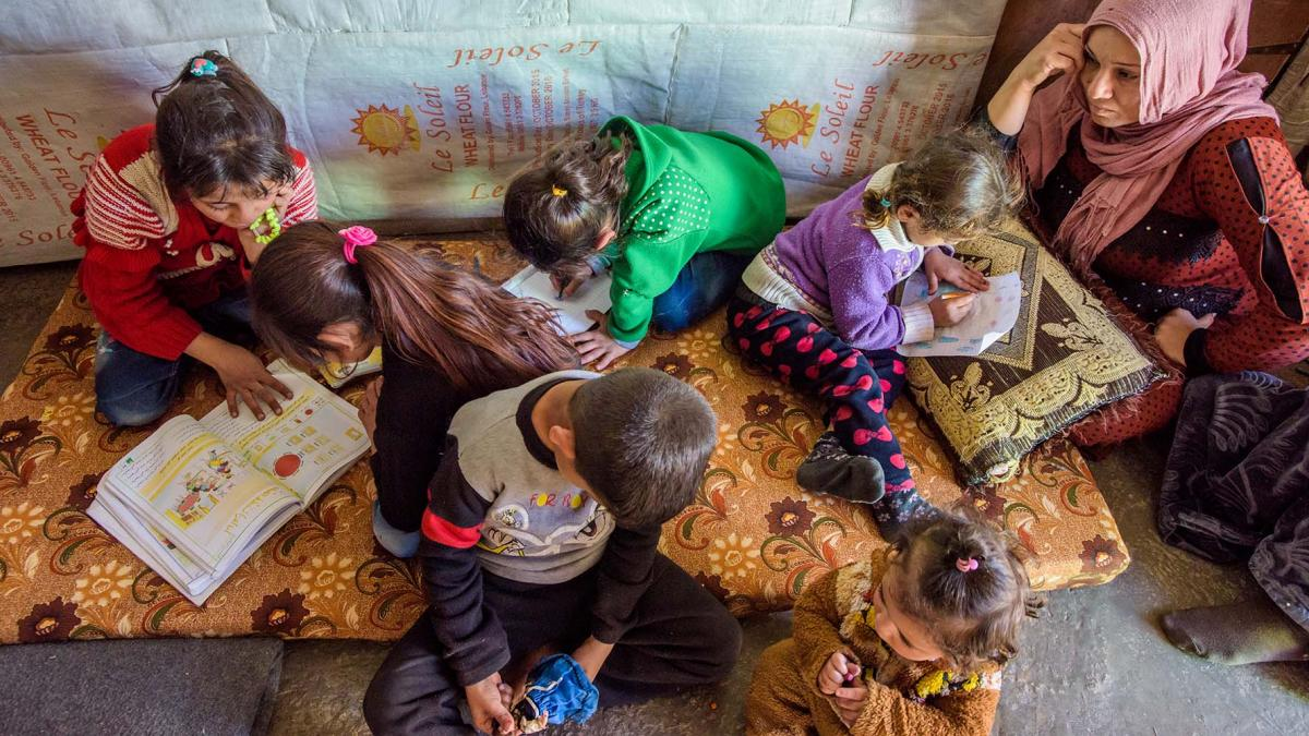 Refugee children doing homework