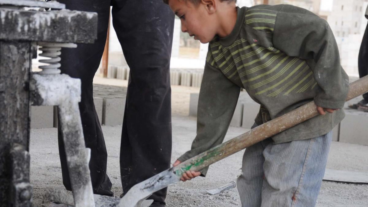 Syrian refugee children work