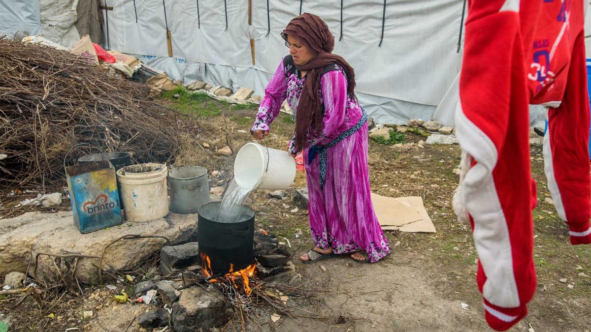 A refugee mother doing laundry