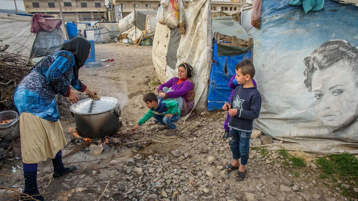 Syrian refugee family cooking dinner