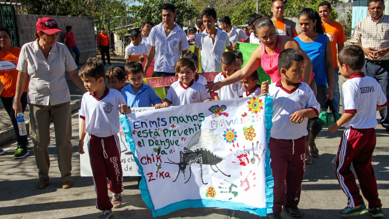 Children in El Salvador march with messages of mosquito awareness to prevent the spread of the Zika virus.